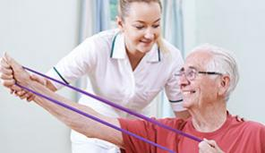 Elderly man doing physical therapy with bands